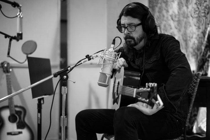 """Dave Grohl tracks an acoustic guitar on the remake of """"Making a Fire"""" on January 13, 2020, the last day of work at the Encino house. Photo: Andrew Stuart"""